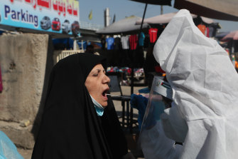 A woman is tested for COVID in Baghdad in February. The nation is still enduring repeated coronavirus outbreaks.