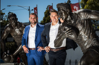 Storm legends Cameron Smith (left) and Billy Slater with their statues at AAMI Park.