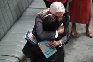 The Minister for Indigenous Australians, Ken Wyatt, embraces Labor's Linda Burney after the Prime Minister's Closing the Gap statement to Parliament in February last year.