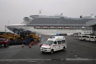 An ambulance leaves the port where the quarantined Diamond Princess cruise ship was docked in Yokohama in February.