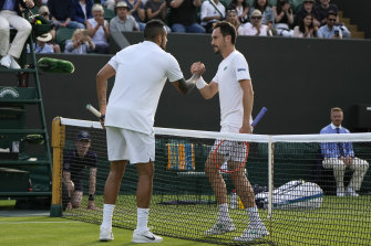 Nick Kyrgios shakes hands with Italy's Gianluca Mager after their match.