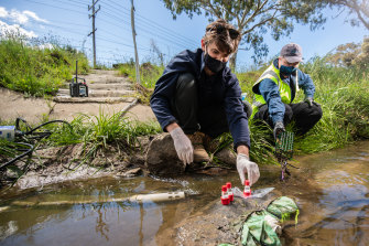 EPA scientist Simon Sharp (left) and Bio2Lab consultant scientist Dave Sharley (right) testing water at Merlynston Creek in Coolaroo.