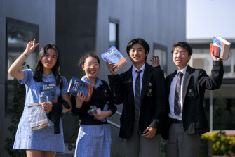 Students at McKinnon Secondary College celebrate the completion of their Chinese VCE exam on Wednesday. From left: Cindy Mao, Amanda Wu, Kun Liu and Henry Zhou.