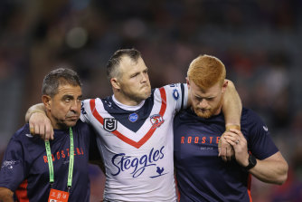 A devastated Brett Morris leaves the field injured after suffering a serious knee injury.