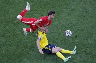 Poland's Bartosz Bereszynski, top, challenges Sweden's Emil Forsberg for the ball.