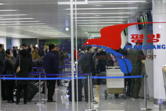 Passengers line up to check in for a flight to Vladivostok at the Pyongyang International Airport earlier this month.