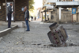 A tail of a rocket is embedded in the ground in Stepanakert in the contested region of Nagorno-Karabakh.