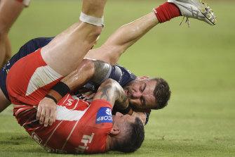 Jack Bird is tackled by Kyle Feldt.