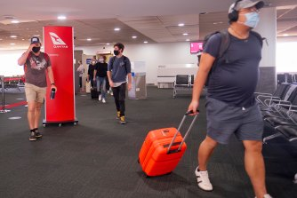 Passengers arriving in Melbourne from Brisbane on Friday.