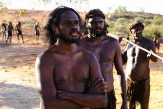 Baykali Ganambarr (front left) as Woorak in Roderick MacKay's feature film The Furnace.
