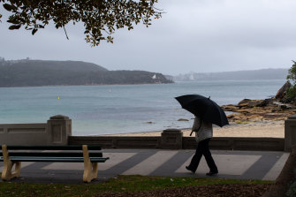 The wet weather at Balmoral Beach on Sunday.