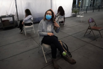Angela Margos, a tourist on her way to visit Maui, Hawaii, sits in a waiting area of San Francisco airport for her test results before her flight.