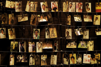 Family photographs of some of those who died hang on display in an exhibition at the Kigali Genocide Memorial centre in the capital Kigali, Rwanda.