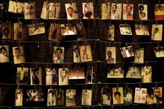 Family photographs of some of those who died in the genocide hang on display in an exhibition at the Kigali Genocide Memorial centre in Rwanda.