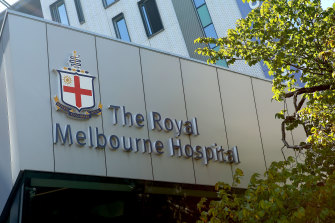 Hundreds of staff have been furloughed amid an outbreak at Royal Melbourne Hospital.