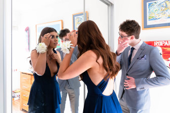 While some schools forbade partners under COVID-19 restrictions, students from co-ed Rose Bay Secondary College took each other. It meant the corsage tradition could be maintained.