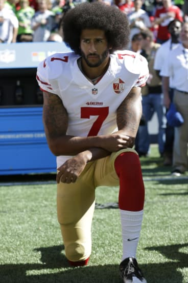 Lionised and vilified: The quarterback has paid a high price for his brave stance.