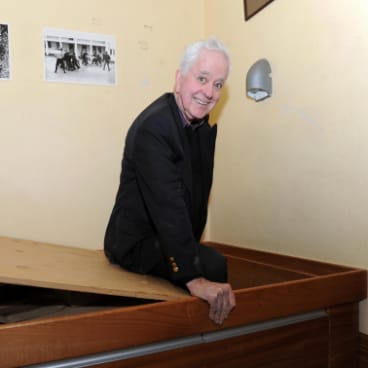 Ross Thomas enters the secret bunker in a Duntroon dormitory that he helped dig as a cadet.