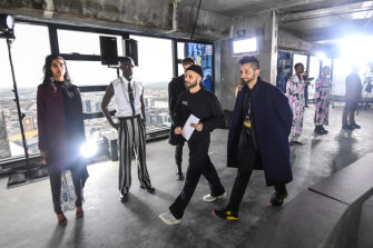 Designers Mario-Luca Carlucci (left) and Peter Strateas perform checks at rehearsals for their show at Melbourne Fashion Week.