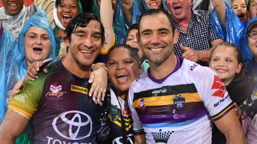 Record-makers: Johnathan Thurston and Cameron Smith at February's testimonial match between the Storm and the Cowboys.