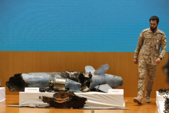 A Saudi military officer walks next to what was described a misfired Iranian cruise missile.