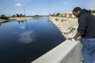 Richard Mootry, a local worker, looks out at the Dominguez Channel, the source of a foul odour in Carson, California.