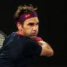 Roger Federer returns a shot against John Millman.