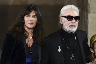 Virginie Viard, left, with Karl Lagerfeld and his godson Hudson Kroenig during the finale of the Chanel Metiers d'Art 2018/19 Show at the Metropolitan Museum of Art on Tuesday, December 4, 2018, in New York.