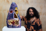 Ramesh Mario Nithiyendran in his studio with Blue Spiky Head with Gold Teeth, 2021.