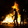 Palestinians stand next to a burning barricade during clashes with Israeli police officers during the holy month of Ramadan on May 8, 2021 in Jerusalem, Israel. Tensions continue in Jerusalem's Old City after clashes in Al-Aqsa Mosque where dozens of Palestinians were seriously injured.