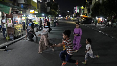 Children play in the middle of Sabang Street, a street food center popular among locals and tourists in Jakarta.