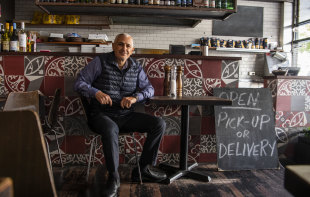 Peter Poulos in his restaurant, Christo's Pizzeria, which is back open for takeaways.
