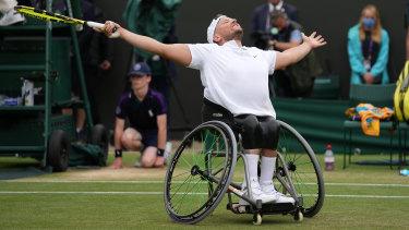 Dylan Alcott celebrates his Wimbledon victory.