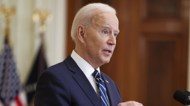 US President Joe Biden speaks during a news conference in the East Room of the White House in Washington, DC.