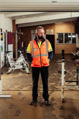 Traralgon Football Netball Club president Kevin Foley surveys the damage to the clubrooms from the recent floods.