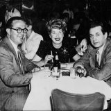 Entrepreneur Harry Wren, his wife, and American producer David Gould on December 12, 1956