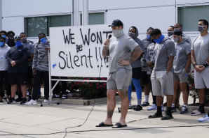 Taylor Decker of the Detroit Lions addresses the media with his teammates outside the team's practice facility.