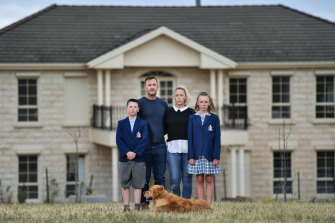 Sabrina Withers with husband Steve, son Tate (9) and her daughter Sienna (13) outside their Keilor home.