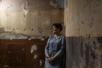 Meredith Robinson, with bullet marks from guns her father and grandfather tested in the upstairs former Egyptian room.