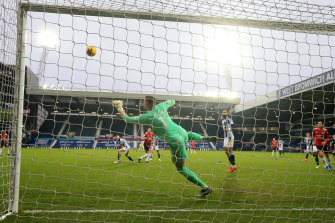 West Brom keeper Sam Johnstone saves a late Harry Maguire shot on goal for United.