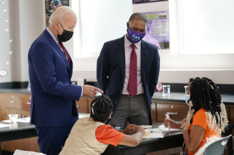 President Joe Biden has been touring schools to promote vaccines, while the federal education department is challenging bans on mask mandates.