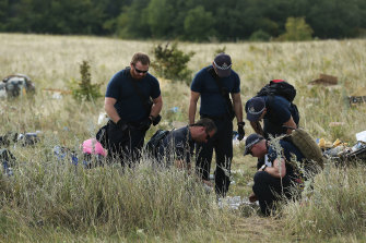 Australian Federal Police officers and their Dutch coutnerparts collect evidence from the MH17 crash site.