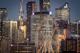 The Melbourne Star Observation Wheel stands unlit against the Docklands skyline on Monday evening.