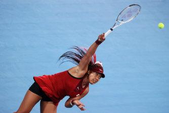 Naomi Osaka serves on day four of the Tokyo Olympics.