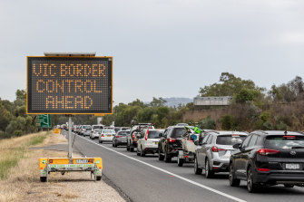 No end in sight: a queue of frustrated motorists stretches back into NSW from the border town of Albury on New Year's Day.