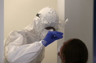 A woman gets tested for COVID-19 in Prague, Czech Republic on Saturday.