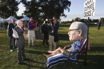 One Nation Senator Malcolm Roberts in debate with a protester wearing a Scott Morrison costume.