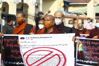 Buddhist monks participate in a protest against the election results with supporters of the Myanmar military and the military-backed Union Solidarity and Development Party near Shwedagon pagoda on Saturday.