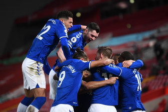 Everton's Gylfi Sigurdsson celebrates with teammates Ben Godfrey, Michael Keane, Dominic Calvert-Lewin and Abdoulaye Doucoure after scoring his team's second goal against Liverpool.