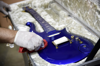 "The ""Blue Angel"" Cloud 2 electric guitar custom-made for Prince in the 1980s is polished at Julien's Auctions warehouse ahead of the auction."